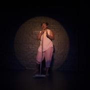 Ghenoa Gela in the spotlight during My Urrwai performance. Image by Daniel Boud.